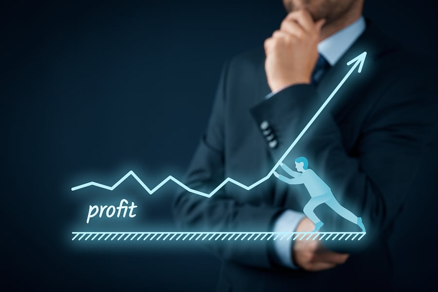 Computer graphic of man holding up profit line with businessman standing in background