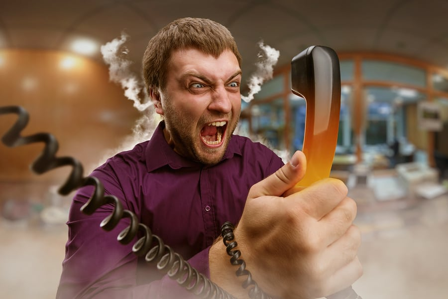 Angry man holding phone