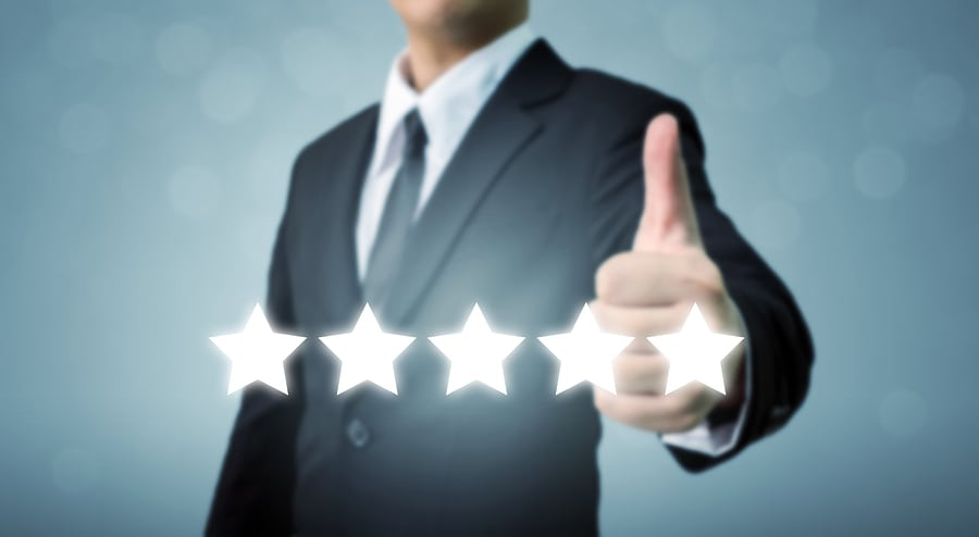 Businessman showing hand sign thumb up and five star symbol to increase rating of company The excellence of the business or service concept
