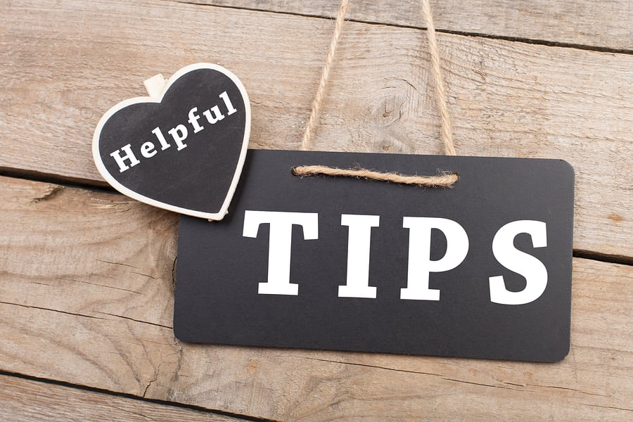 "Blackboards with inscription ""Helpful TIPS"" on wooden background"
