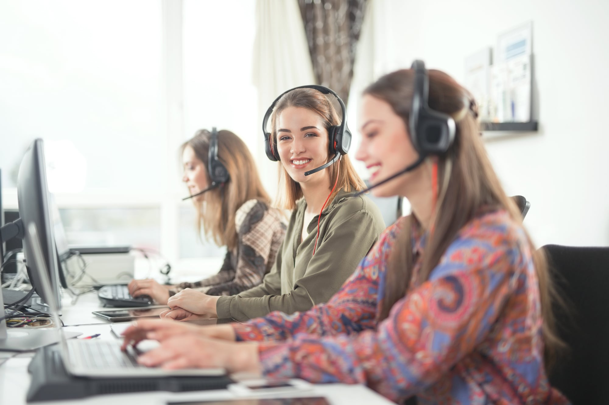 Group of busy young businesswomen working as call center operators