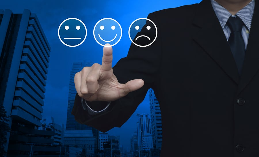 Businessman pressing excellent smiley face rating icon over modern office city tower, Business customer service evaluation and feedback rating concept